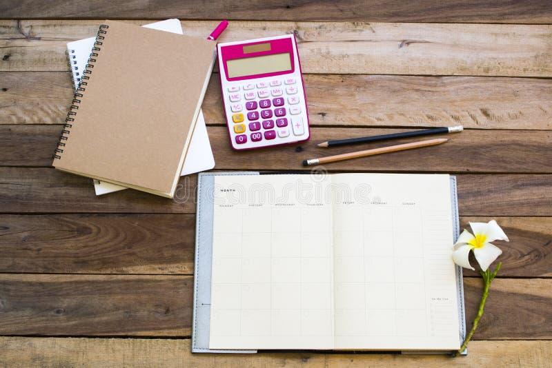 Плановик тетради, калькулятор для работы дела стоковое изображение