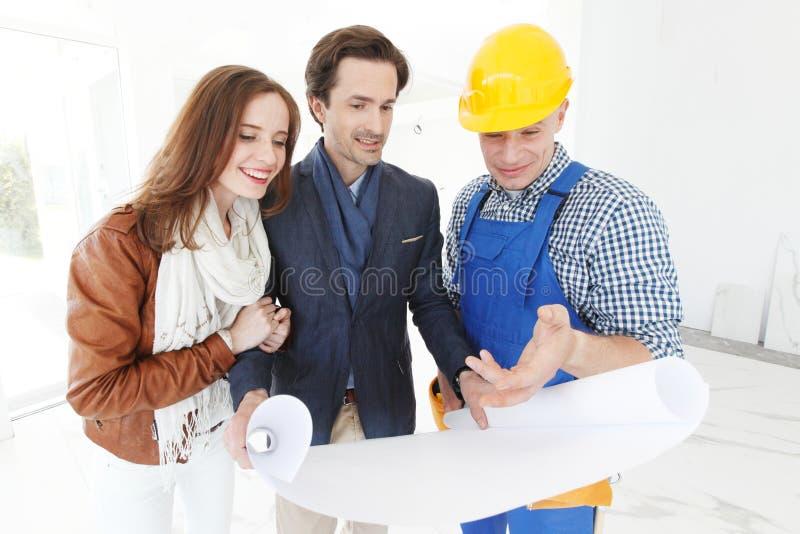 Планы дизайна дома выставок работника стоковые изображения