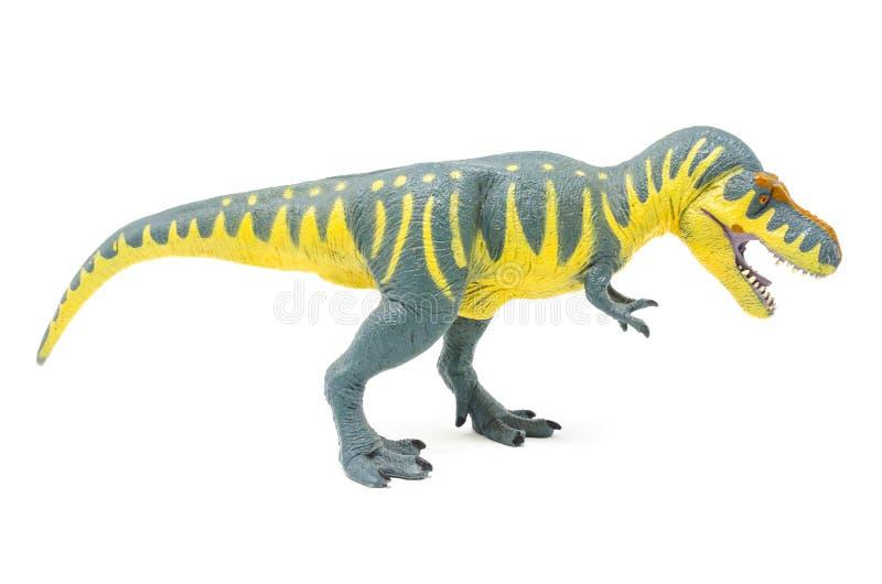 Пластиковая желтая голубая сторона 3 игрушки динозавра Rex тиранозавра стоковые изображения rf