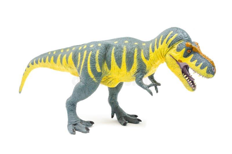 Пластиковая желтая голубая сторона 2 игрушки динозавра Rex тиранозавра стоковая фотография rf