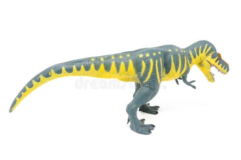 Пластиковая желтая голубая сторона 1 игрушки динозавра Rex тиранозавра стоковое фото rf
