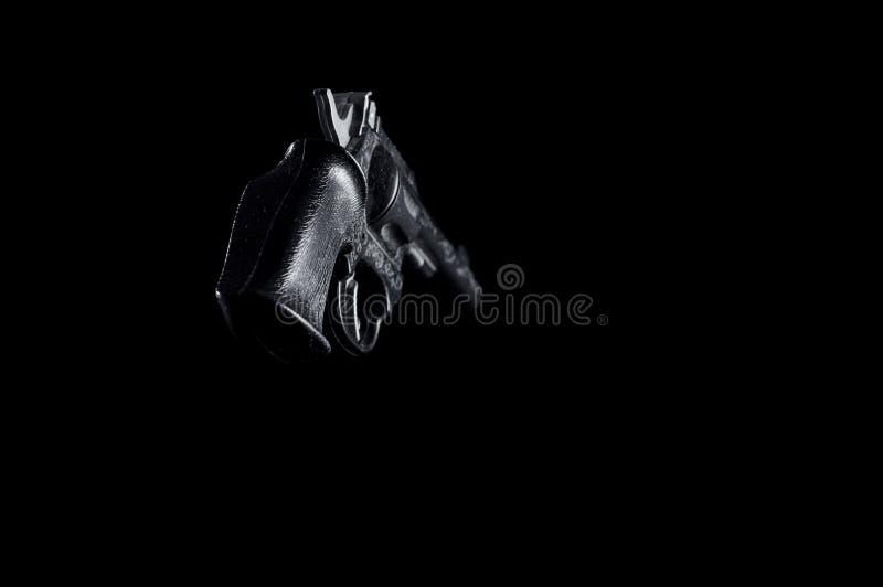 Пластиковое оружие на черной предпосылке, изолят стоковая фотография rf