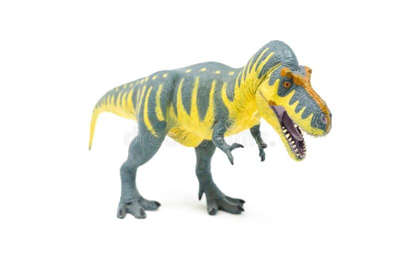 Пластиковый желтый голубой фронт 1 игрушки динозавра Rex тиранозавра стоковая фотография rf