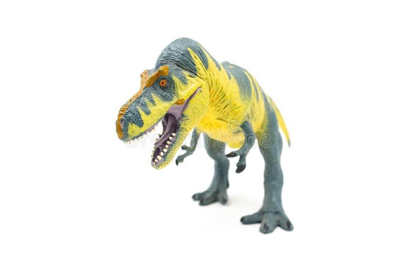 Пластиковый желтый голубой фронт 2 игрушки динозавра Rex тиранозавра стоковое фото rf