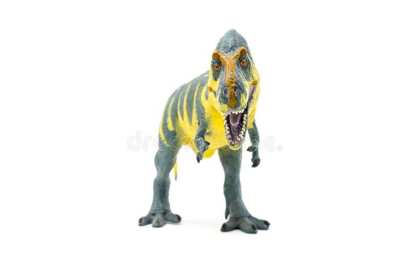 Пластиковый желтый голубой фронт 3 игрушки динозавра Rex тиранозавра стоковое изображение