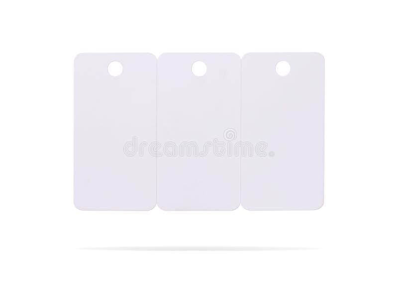Пластиковый набор карты изолированный на белой предпосылке Ценник или вися ярлык для вашего дизайна Пути клиппирования или отреза стоковые фотографии rf