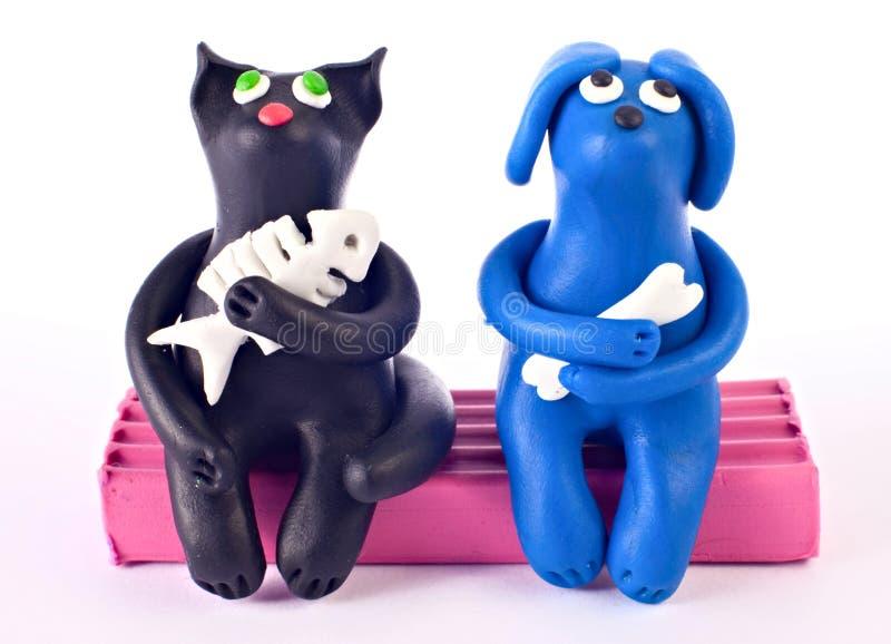 пластилин собаки кота стоковые изображения