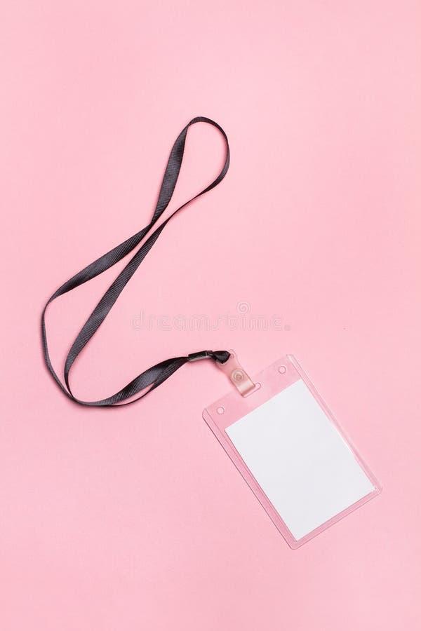 Пластичное идентификация на розовой предпосылке стоковые фото