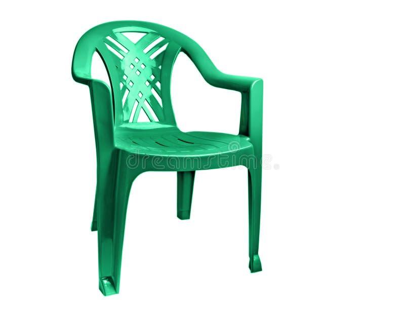 пластмасса стула изолированная зеленым цветом стоковое фото