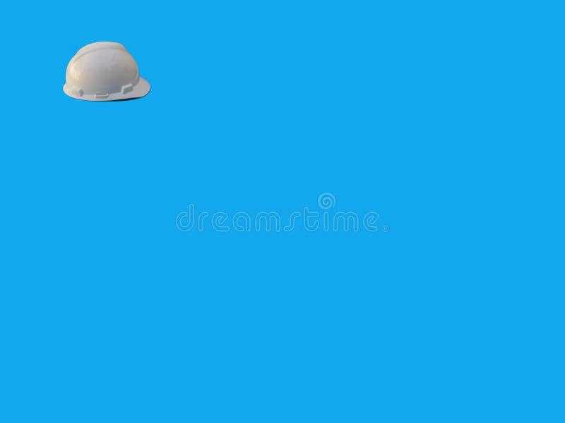 Пластмассовый надежно-белый защитный шлем на белом фоне стоковая фотография