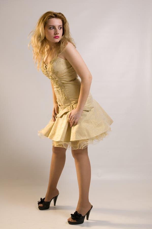 платье золотистое стоковая фотография rf