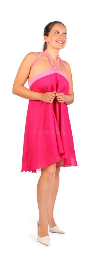 Платье красивейшей женщины нося усмедется в студии стоковое фото rf