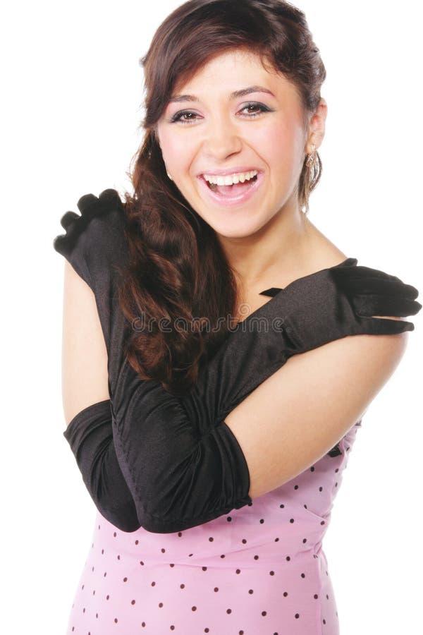 платье смеясь над розовой женщиной стоковая фотография rf