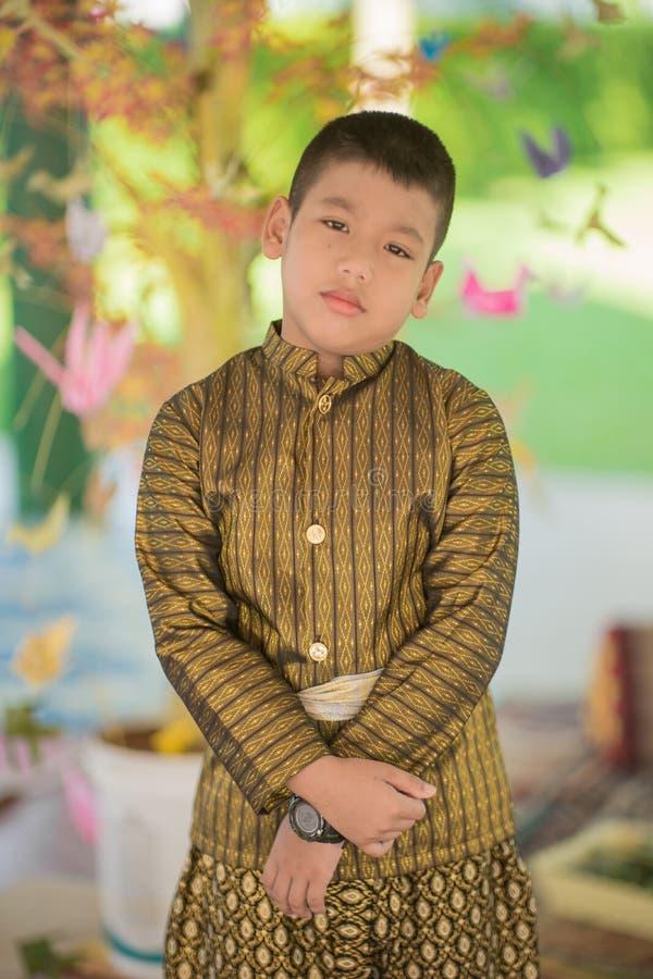 Платье тайского ребенка традиционное стоковые изображения rf