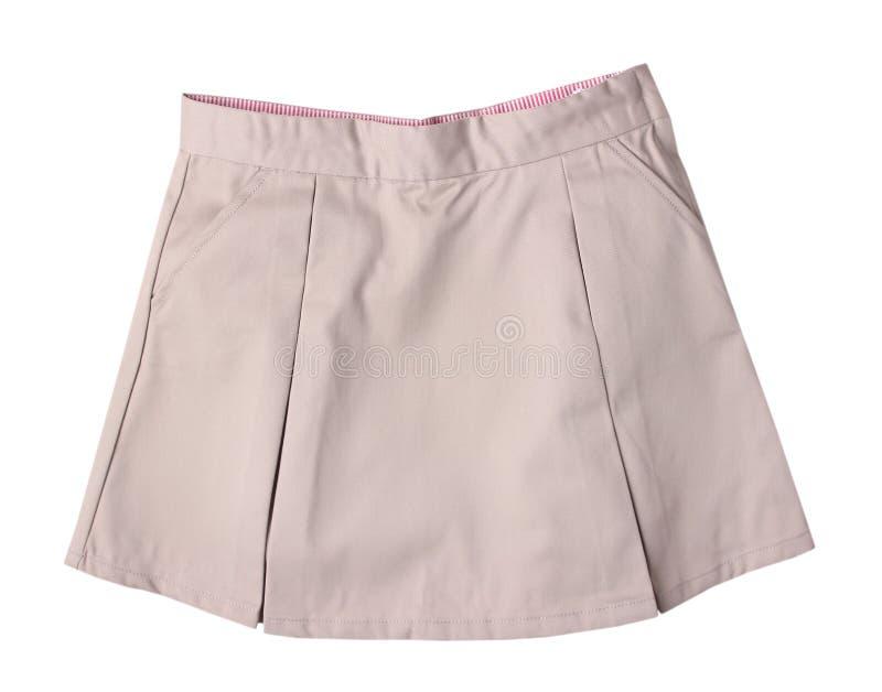 Плиссированная бежевая юбка изолированная на белизне стоковые фото