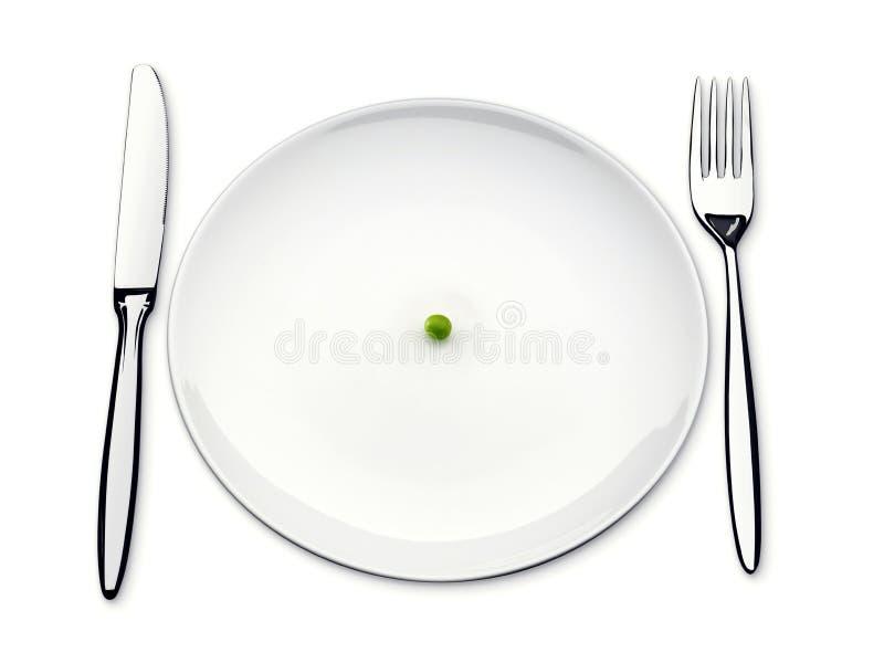 Плита обедающего с одним горохом и вилкой и ножом стоковые изображения rf