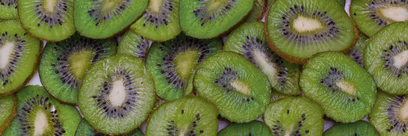 Плодоовощ кивиа отрезка Текстура предпосылки конца-вверх стоковое фото