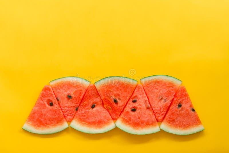 Плоды лета со свежим арбузом на желтой предпосылке цвета стоковая фотография rf