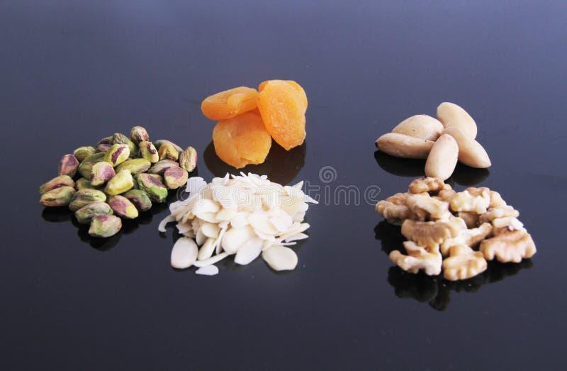 Плод сухой Сан-Паулу Бразилия предпосылки обзора гайки грецкого ореха миндалины фисташки Дамаска белый стоковая фотография rf