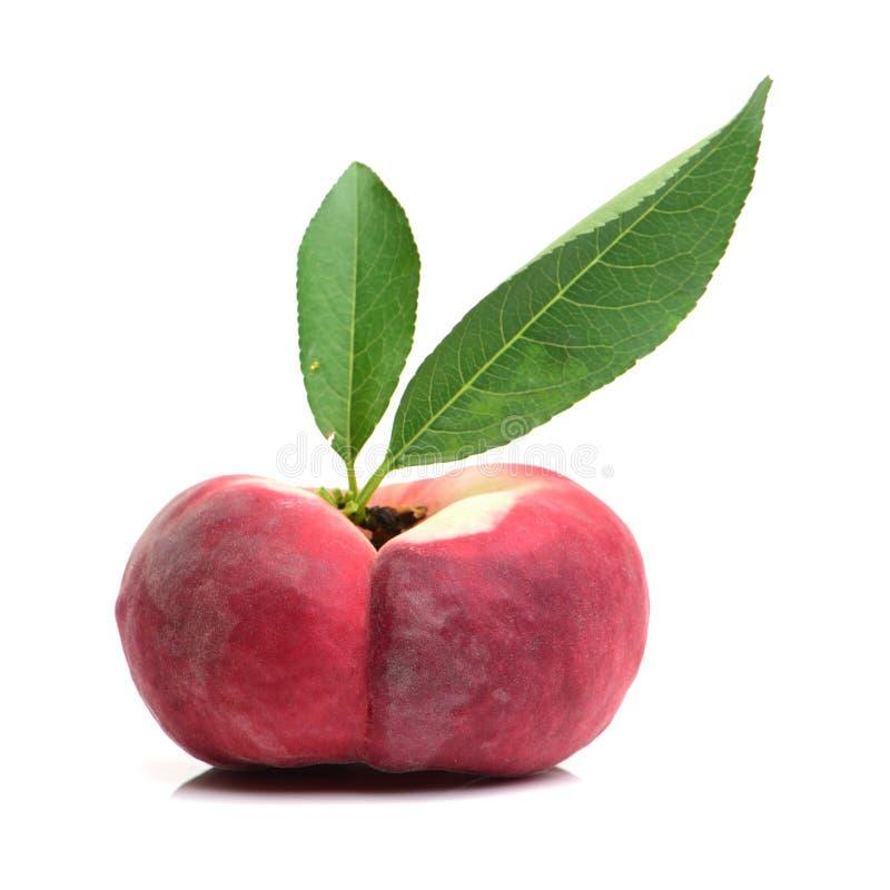 плоский персик стоковые фото
