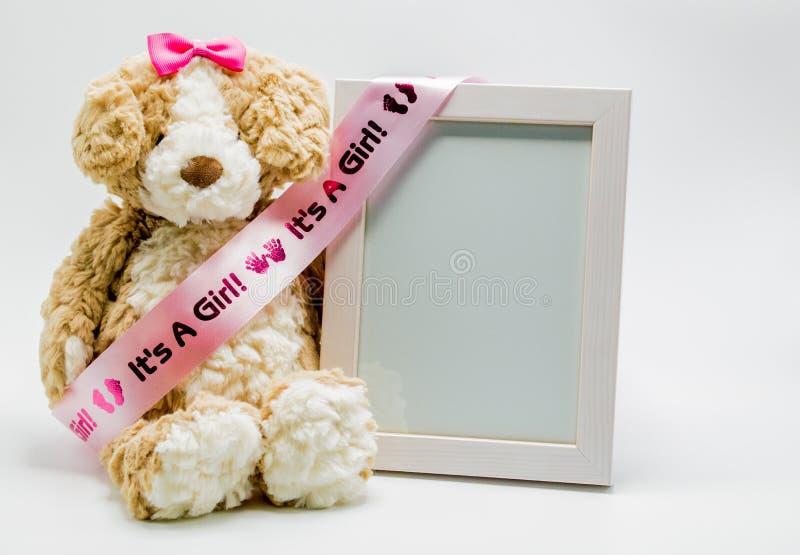 Плюшевый медвежонок плюша и пустая картинная рамка с ` оно ` s лента ` девушки стоковые фото