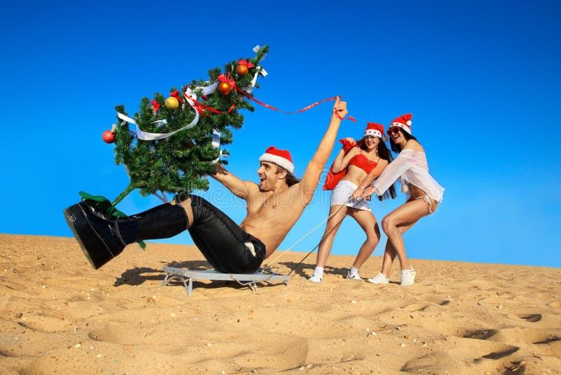 пляж вытягивая santa santas сексуальные стоковые фотографии rf