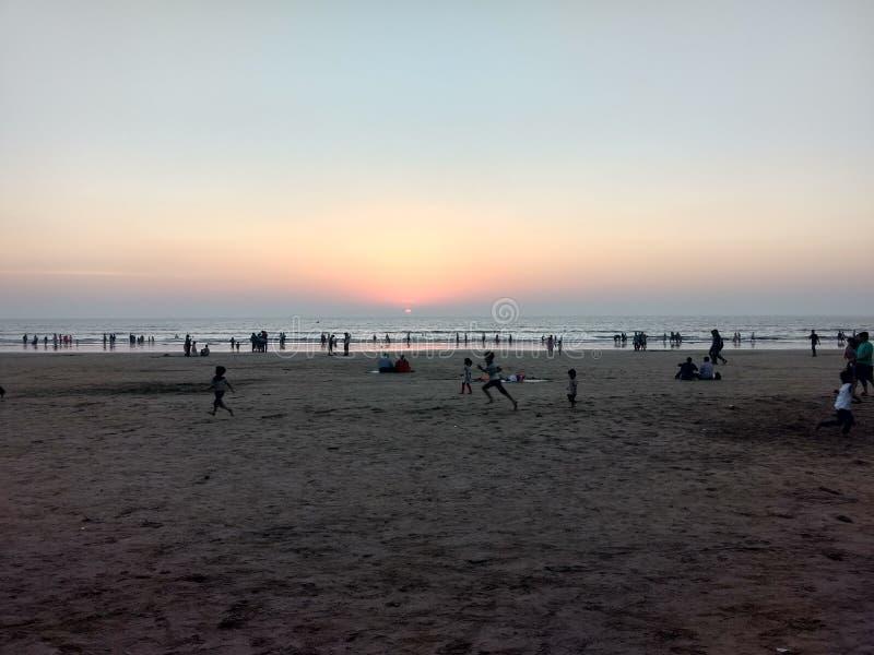 Пляж и заход солнца стоковые фото