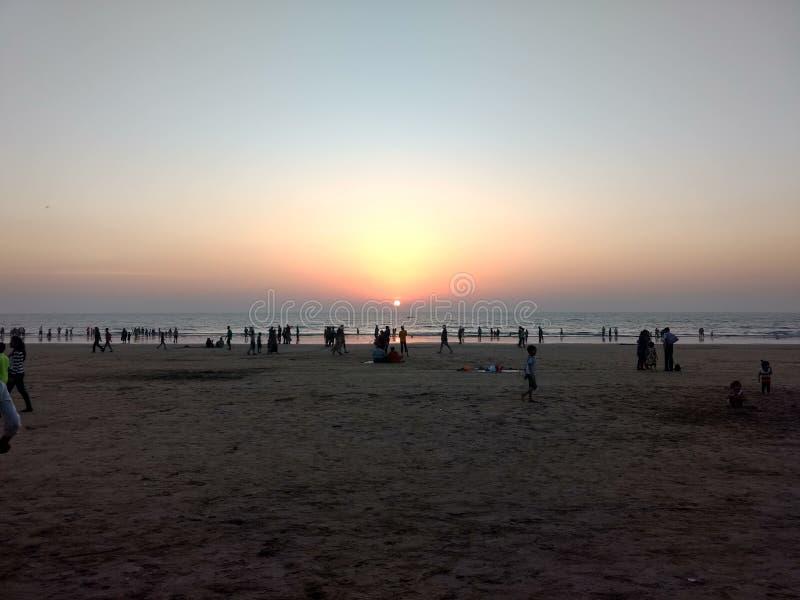 Пляж и заход солнца стоковое фото