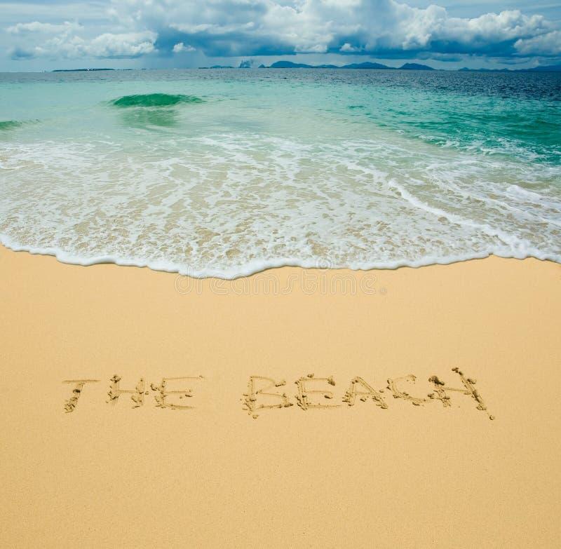 Пляж написанный в песочном тропическом пляже стоковое изображение