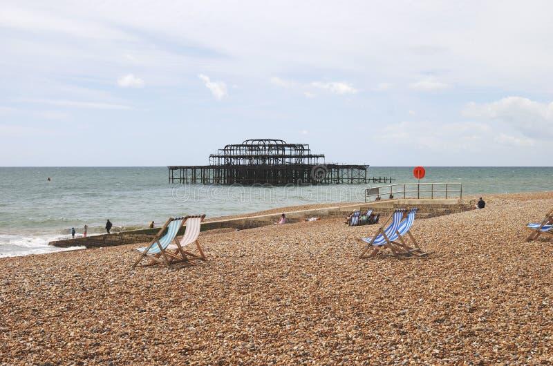 Пляж Brighton и западная пристань. Великобритания стоковое изображение rf