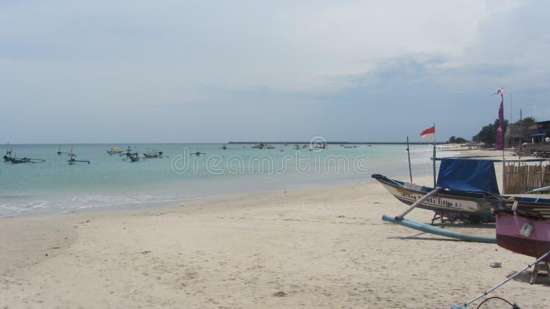 Пляж Jimbaran, остров Бали, индонезийский стоковая фотография
