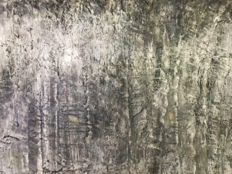 Поверхность старых серых бетонных стен выглядит сильной, устойчивый ко всепогодным условиям Украсьте и внутри и снаружи стоковая фотография