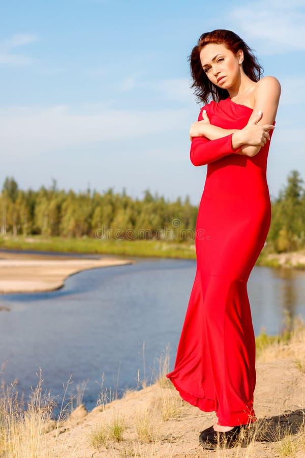 Повелительница в красном платье стоковое изображение rf