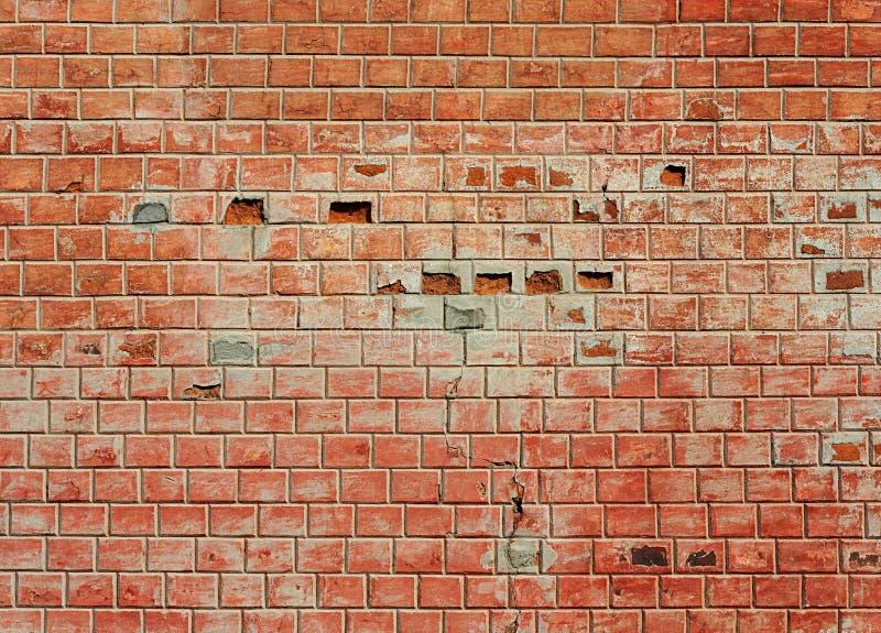 Поврежденная красная предпосылка кирпичной стены стоковые изображения rf