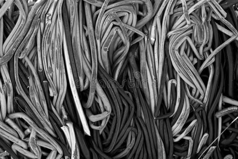 Повторно использовать разбивочные кучи трубопровода, металла и других материалов утиля стоковое изображение