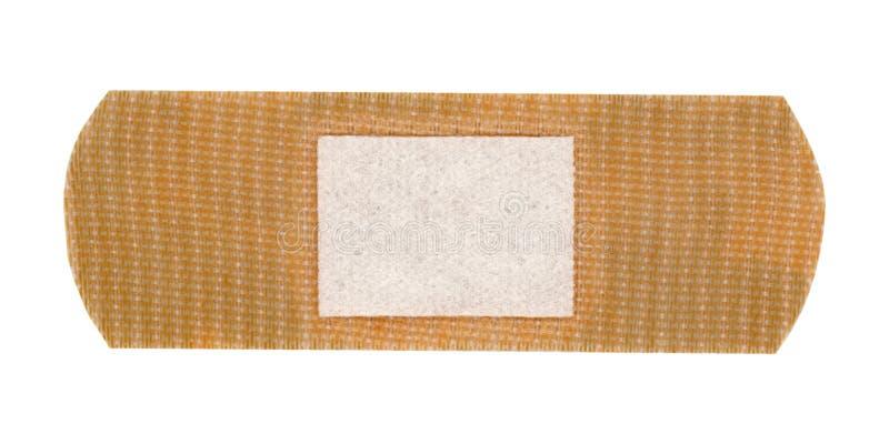 повязка помощи диапазона изолированная над белизной стоковые фото
