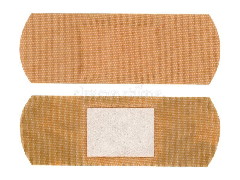повязка помощи диапазона изолированная над белизной стоковое изображение rf