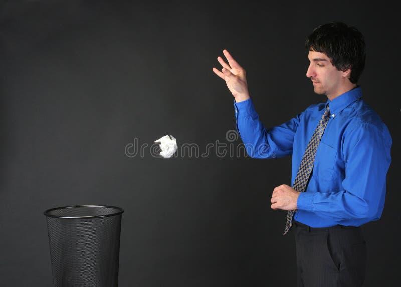 погань бизнесмена бросая стоковое изображение