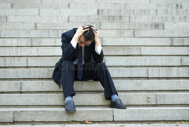 подавленный человек стоковое фото