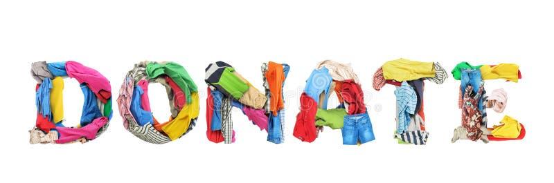 Подарите знак сделанный из изолированных одежд на белой предпосылке стоковые фото
