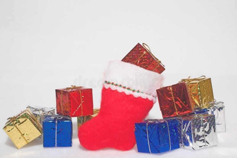 Подарки на рождество & чулок стоковое изображение