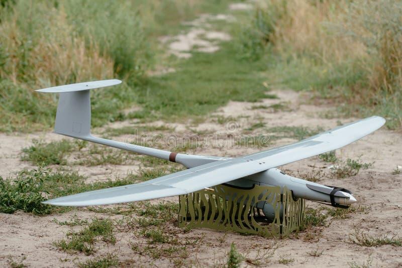 Подготавливать трутней армии для полета Aircra рекогносцировки стоковое фото