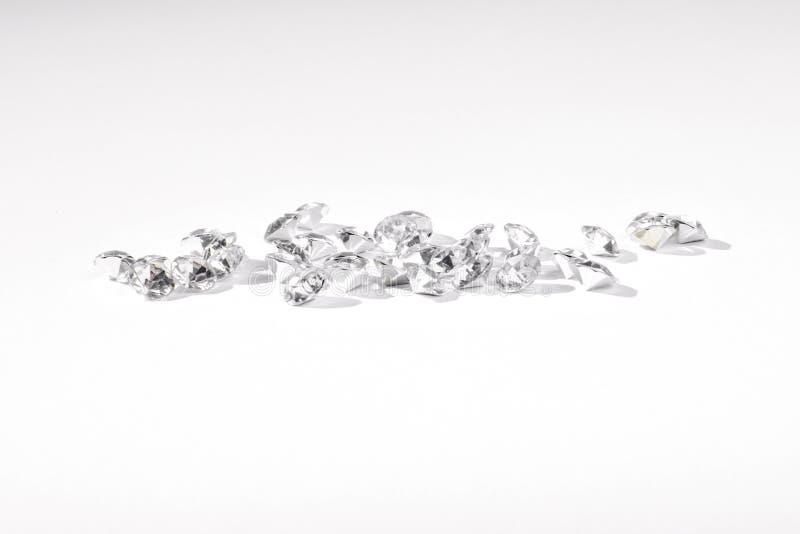 Поддельные диаманты на белой предпосылке стоковые изображения rf