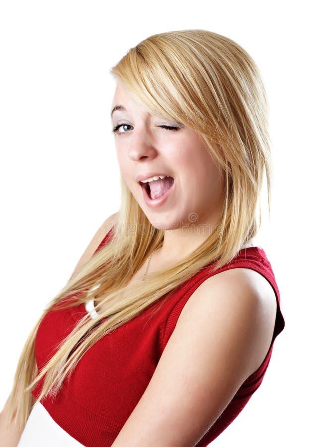 подмигивать белокурой девушки предназначенный для подростков стоковое фото rf