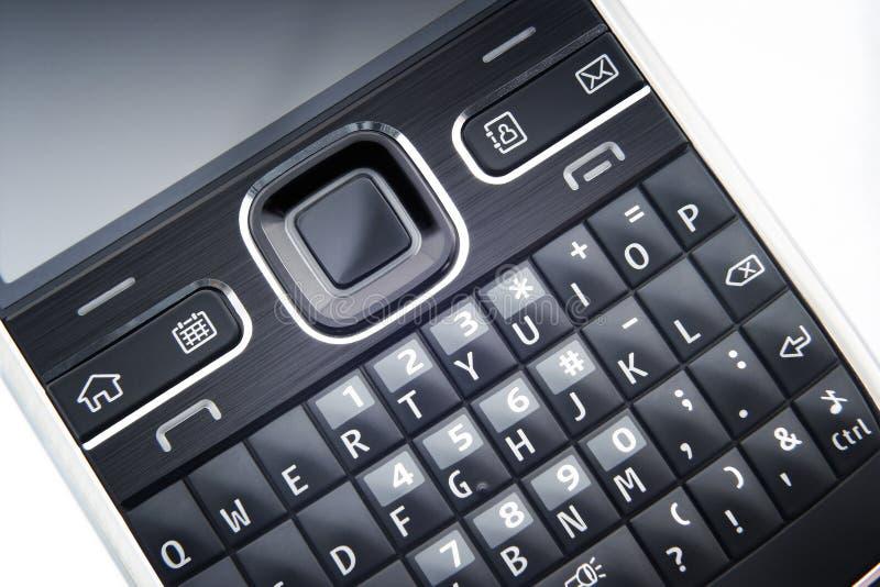 поднимающее вверх близкого телефона клавиатуры франтовское стоковые изображения