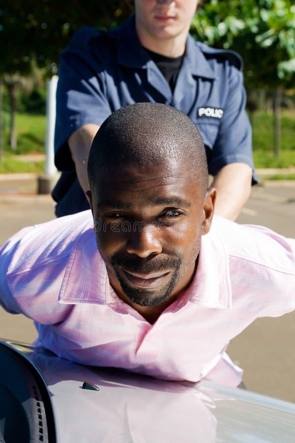 подозреваемый арестования стоковая фотография rf