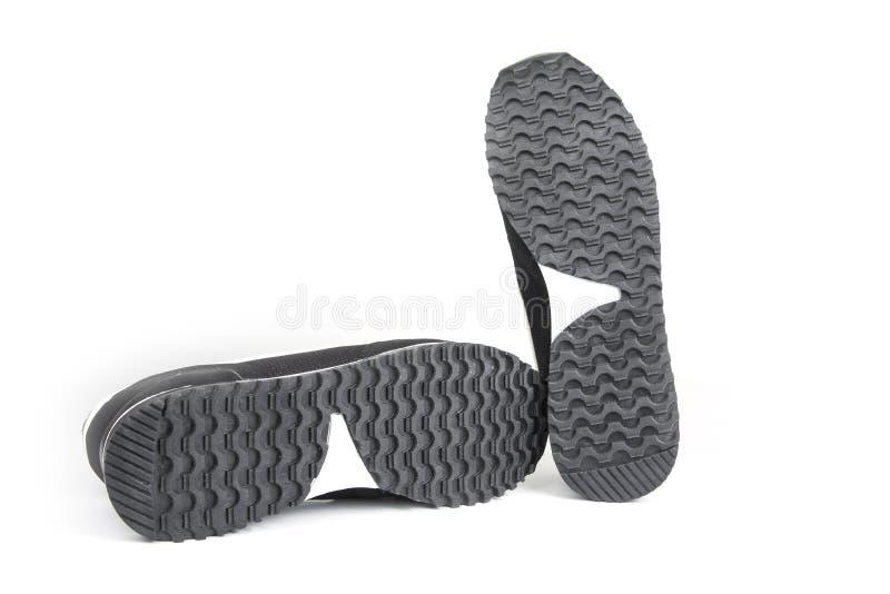 Подошвы ботинок спорта на белой предпосылке стоковые изображения rf