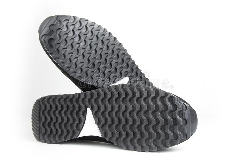 Подошвы ботинок спорта на белой предпосылке стоковое фото rf