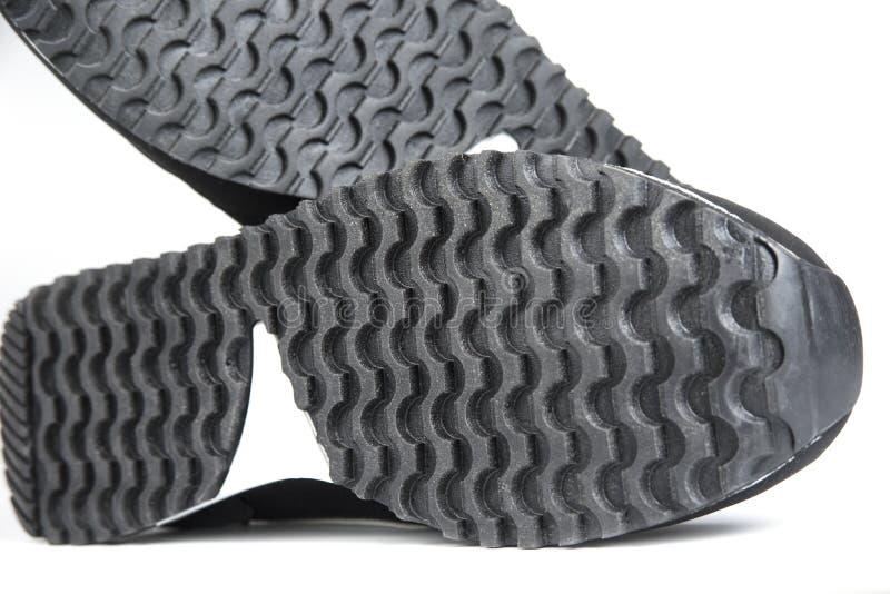 Подошвы ботинок спорта на белой предпосылке стоковая фотография rf