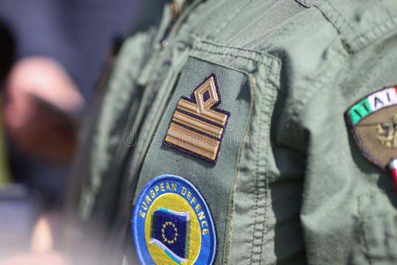 Подробности с пропуском Европейского агентства обороны на итальянскоРстоковое фото